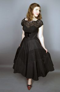woman_wearing_black_taffeta_dress